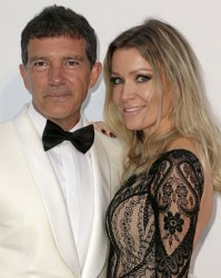 Antonio Banderas and Nicole Kimpel attend the amfAR Gala in Antibes