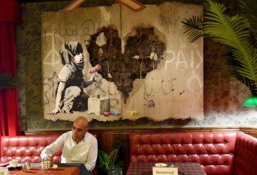 An Art Work By Graffiti Artist Banksy In Bethlehem