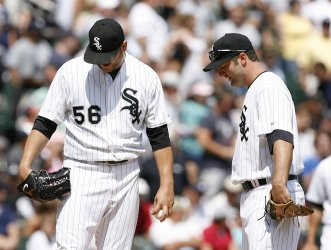 Chicago White Sox first baseman Paul Konerko talks with starting pitcher Mark Buehrle against the New York Yankees