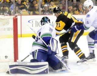 Penguins Center Evgeni Malkin Scores against Canucks