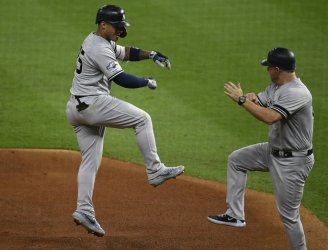 Yankees Torres celebrates solo homer in ALCS