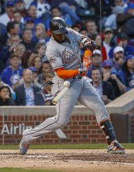 Marlins Marcell Ozuna bats against the Cubs in Chicago