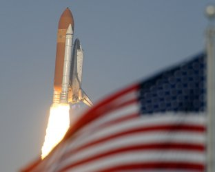 NASA's space shuttle Discovery launches from the Kennedy Space Center