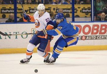St. Louis Blues Patrik Berglund and New York Islanders Anders Lee tie up