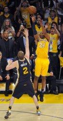 Los Angeles Lakers Kobe Bryant goes up for a basket in his final game against Utah Jazz' Joe Ingles