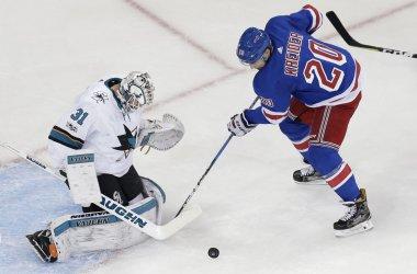 Rangers Chris Kreider tries to score on Sharks Martin Jones