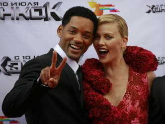 Actors Will Smith and Charlize Theron arrive for the opening of the Moscow Film festival