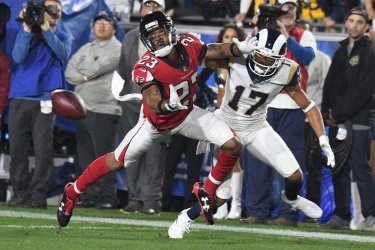 Falcons Robert Alford defends against Rams Robert Woods in NFC Wild Card Playoff Game