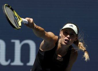 Caroline Wozniacki of Denmark serves at the US Open