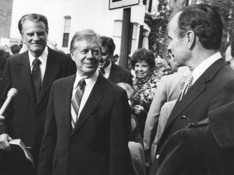 President Jimmy Carter, Vice President-elect George Bush and Evangelist Billy Graham meet after church services