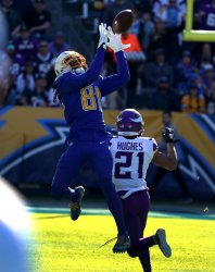 Los Angeles Chargers' receiver Mike Williams hauls in a pass defended by Minnesota Vikings Mike Hughes