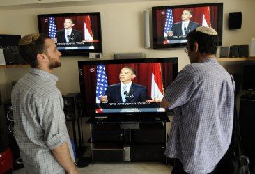 Israelis watch U.S. President Barak Obama deliver his speech from Cairo in an appliance store in Jerusalem