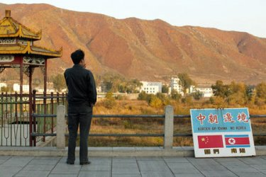 A CHINESE TOURIST VISITS CHINA'S NORTHERN BORDER WITH NORTH KOREA