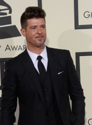 Robin Thicke arrives for the 58th annual Grammy Awards in Los Angeles