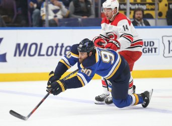 St. Louis Blues Ryan O'Reilly is tripped up by Carolina Hurricanes Justin Williams