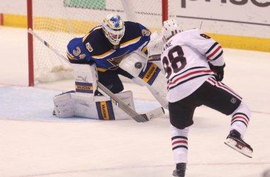 St. Louis Blues goaltender Jake Allen makes save