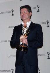Simon Cowell arrives in the press room for the 38th International Emmy Awards in New York