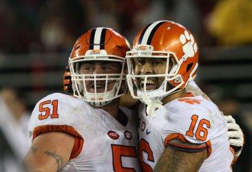 Clemson Tigers' Jordan Leggett, right, and Taylor Hearn celebrate Leggett's scoring of the winning touchdown
