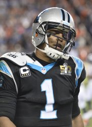 Panthers QB Cam Newton walks off the field in defeat