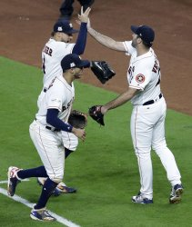 Astros Springer makes leaping catch in the seventh in the ALCS