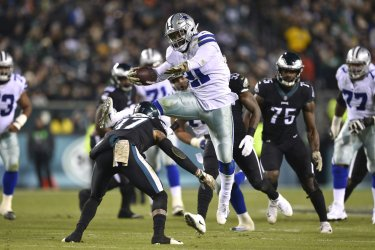 Cowboys running back Ezekiel Elliott hurdles Eagles Tre Sullivan