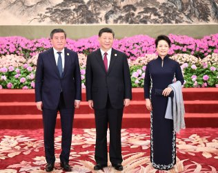 Xi, Peng and Jeebekov pose for a photo at the BRF in Beijing, China