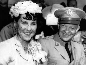General Dwight Eisenhower and his wife Mamie attend a 1947 New Year's Day football game in Miami.