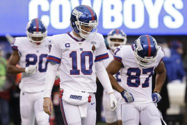 New York Giants Eli Manning stands on the field