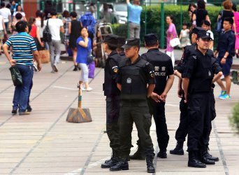 Chinese security is stepped up in Urumqi