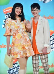 Grey Griffin and Tex Hammond attend Kids' Choice Awards