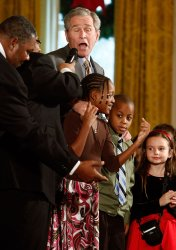 President And Mrs. Bush Attend Children's Holiday Reception in Washington