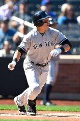 New York Yankees center fielder Jacoby Ellsbury hits a lead off single