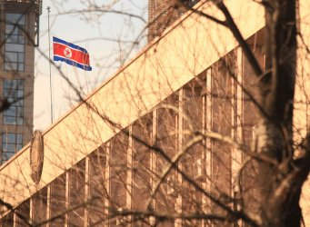 The North Korean flag flies at half-mast in Beijing