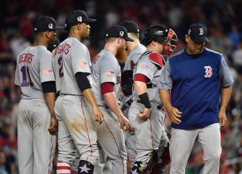 Red Sox manager Alex Cora meets on the mound