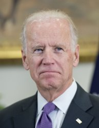 VP Joe Biden Watches as President Obama Speaks on Afghanistan