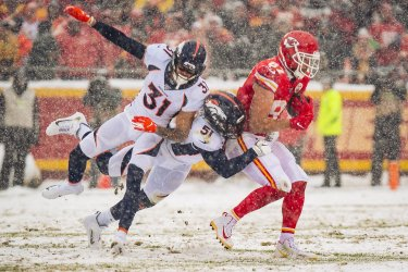Chiefs' Travis Kelce is tackled by Broncos Todd Davis and Justin Simmons