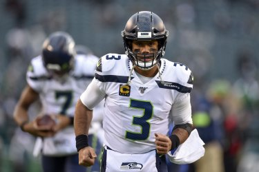 Seahawks' Russell Wilson (3) warms-up