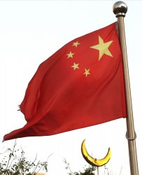 China's national flag flies above a Islamic mosque in Beijing, China