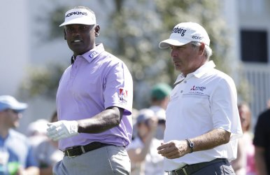 Vijay Singh and Freddie Couples practice at the Masters