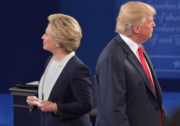 Donald Trump and Hillary Clinton depart after the presidential debate