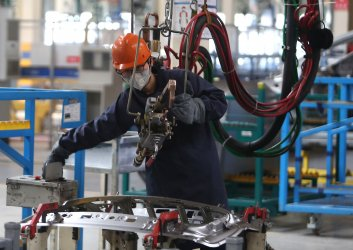 An engineer works at Geely's factory near Taiyuan, China