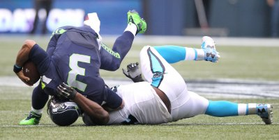 Seahawks quarterback Russell Wilson sacked by Panthers Ealy