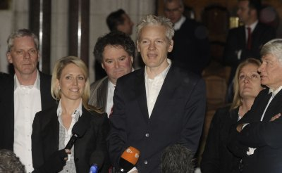 Julian Assange speaks to the media after gaining bail in London
