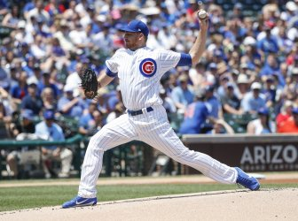 Cubs Mike Montgomery delivers against the Brewers in Chicago