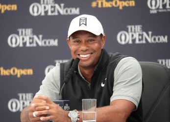 Tiger Woods speaks to the media before the start of the Open Championship