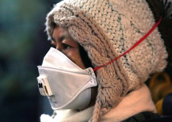 A Chinese woman wears an air mask in Beijing