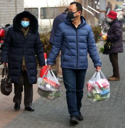 Chinese wear protective face masks in Beijing, China