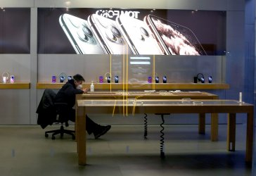An Apple store is closed due the virus in Beijing, China