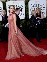 Amber Heard attends the 73rd annual Golden Globe Awards