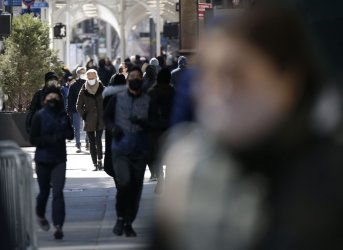 Pedestrians Walk on Fifth Avenue in New York City